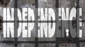 Independence Written On A Wall. With Jail Bars Shadow Stock Images