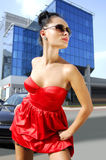 Independent brunette in sunglasses on street Royalty Free Stock Photography