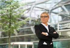 Independent business woman standing outdoors Royalty Free Stock Images