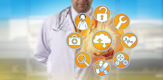 Independent Physician Accessing Managed Services. Unrecognizable independent physician is accessing managed services via the cloud. Medical sector and royalty free stock images