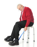 Independent Senior Using Assistive Dressing Device Royalty Free Stock Photo