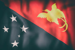 Independent State of Papua New Guinea flag. 3d rendering of  an old Independent State of Papua New Guinea flag waving Royalty Free Stock Photos