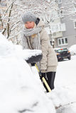 Independent woman shoveling snow in winter. Stock Images