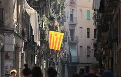Barcelona streets with independence catalonia flag. Independententist flags wave from some balcony in barcelona the day after the referendum poll day in Royalty Free Stock Image