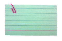 Index card with. A paper clip Stock Images