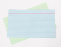 Index Cards. Two blank index cards, blue on green royalty free stock photos