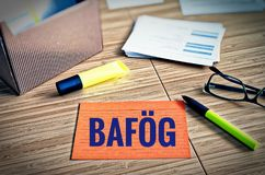 Index cards with legal issues with glasses, pen and bamboo with the german word Bafög who means the law to support students in ge stock photo