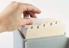 Index File. Reaching into the card index file for business contact number Royalty Free Stock Photography