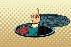 Index finger from manhole Stock Images