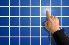 Index finger pointing on blue square Stock Photography