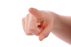Index finger pointing at viewer. Isolated stock image