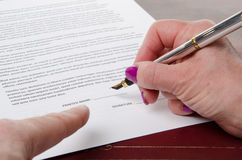 Index finger showing where to sign Royalty Free Stock Photos
