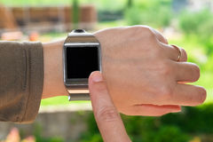 Index finger on smartwatch Stock Images