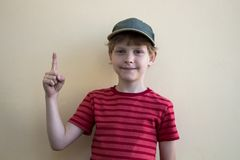 Index finger up. The boy is pointing his finger up royalty free stock images