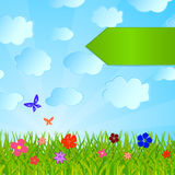 The index on a summer background with a grass, flowers, the sky. And butterflies Stock Photo