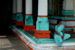 India 01. Woman sitting in india temple royalty free stock image