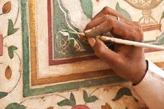 India, Amberfort: restauratie van muurverven stock afbeeldingen
