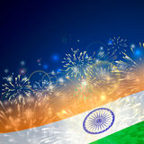 India background in tricolor and Ashoka Chakra with festive fireworks bursts. Concept of Indian Republic Day. Celebrations or Independence day. Flag over bright Stock Image