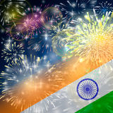 India background in tricolor and Ashoka Chakra with festive fireworks bursts. Concept of Indian Republic Day. Celebrations or Independence day. Flag over bright Royalty Free Stock Photos