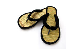 India-Bamboo Slippers. Handmade bamboo stick and velvet slippers isolated on white Royalty Free Stock Photo