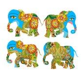 India. Beautiful elephants with flowers on white background. Decorative silhouettes. Stock Photos