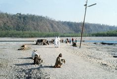 1977. India. Rishikesh. Blind beggars along a path leading to Ganges. Royalty Free Stock Images