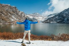 India - Boy and Mountain Lake in Sikkim stock photography