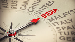 India. Business background concept. Compass with needle pointing to India. Red and beige tones plus blur effect stock illustration