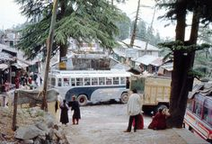 1977. India. Busses coming and going at upper Dharamsala. Stock Photos