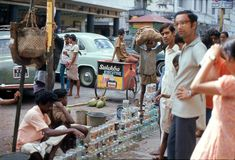 1975. India. Calcutta. Fish for sale. Description: The photo shows how on a market street, in Calcutta, colourful ornamental fish are offered for sale Stock Image