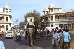 1977. India. A ceremonial elephants is passing through the streets of Jaipur. The photo shows, how a ceremonial elephant is being a part of the everyday traffic Royalty Free Stock Image
