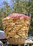 India Chapatti. Big basket of chapattis, a kind of flat pans, common in India, carried on head royalty free stock photo