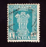 INDIA - CIRCA 1950: Cancelled postage stamp printed by  Indian mind shows four Indian lions capital of Ashoka Pillar, circa 1950.  royalty free stock photography