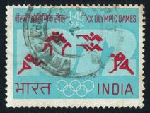 Shooting and hockey. INDIA - CIRCA 1972: stamp printed by India, shows Olympic rings, symbols for running, wrestling, shooting and hockey, circa 1972 Stock Images