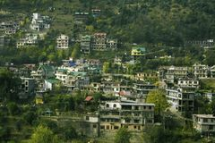India City established on mountains with green trees. Wooden house of mountains area with green hills established on mountain range royalty free stock images