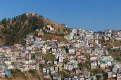 India - city in Himalaya. View on the Indian city in Himalaya mountains near Shimla stock images