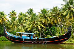 India. Coco trees reflection and beautifoull house boat at back waters of Kerala Royalty Free Stock Image