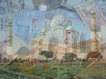 India Currency Passports and Taj Mahal. A composite of Indian Currency, Passports and the Taj Mahal. All photos were taken by the author and combined into a Stock Photos
