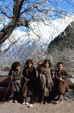 1977. India. Himalaya. Children enjoying the first spring sun. Description: The photo shows, 4 little girls in their traditional clothing Stock Image