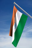 India Flag. Clipping path, hanging from flag pole against blue sky stock illustration