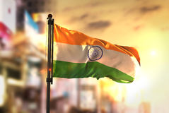 India Flag Against City Blurred Background At Sunrise Backlight. Sky royalty free stock photo