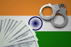 India flag with handcuffs and a bundle of dollars. The concept of illegal banking operations in US currency royalty free stock photography