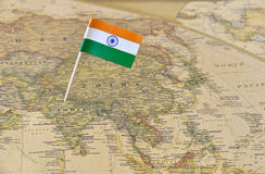 India flag pin on map. India paper flag pin on an ancient map stock photo