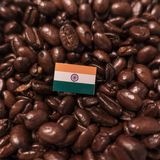 A India flag placed over roasted coffee beans royalty free stock image