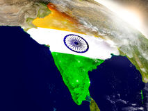 India with flag in rising sun Stock Photography