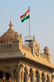India Flag on vidhana soudha. The Indian flag on a mast atop the state legislature building in bangalore stock photos