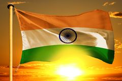 India flag weaving on the beautiful orange sunset with clouds background. India flag weaving on the beautiful orange sunset background stock photography