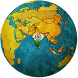 India on globe map. Isolated over white territory of india with flag on globe map Stock Photo