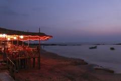 India - Goa - Anjuna. India - Goa - A bar along the Anjuna beach at dusk Royalty Free Stock Images