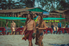 India, Goa - December 4, 2016: A couple of hippies with dreadlocks on the beach of Arambol Stock Photos